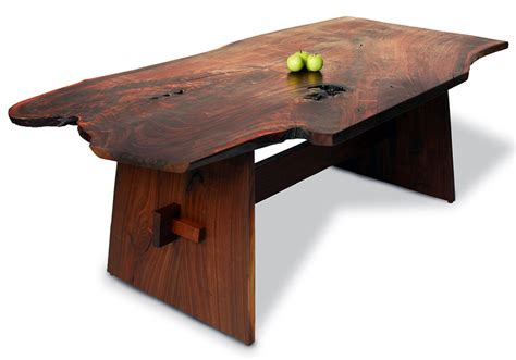 the table is a wood slab dining table this table s