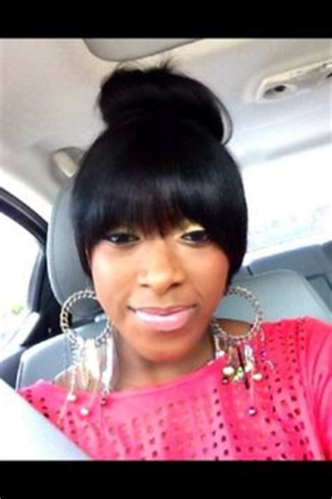 black hairstyles with bun and bangs 1000 images about black weave hairstyles on pinterest