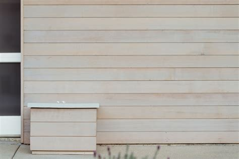 Instyle Home Decor light gray stain at cedar siding midcentury exterior