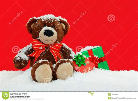 gift wrapped teddy bears teddy in the snow with gifts royalty free stock photo