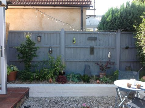 grey fence white painted wall garden yard