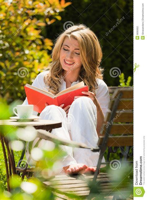 Garden Reading Book Reading A Book In The Garden Stock Photography
