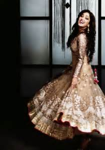 oh the glitz and light brown and gold anarkali