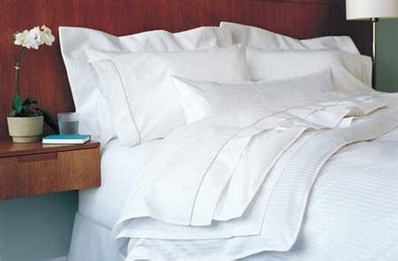 ritz carlton down comforter luxury suite deluxe package featuring bedding found in