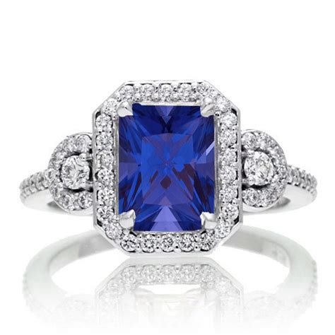 3 carat emerald cut sapphire and white halo