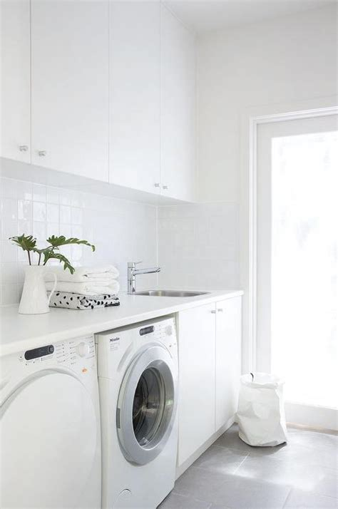 laundry white white laundry room with gray floor tiles modern