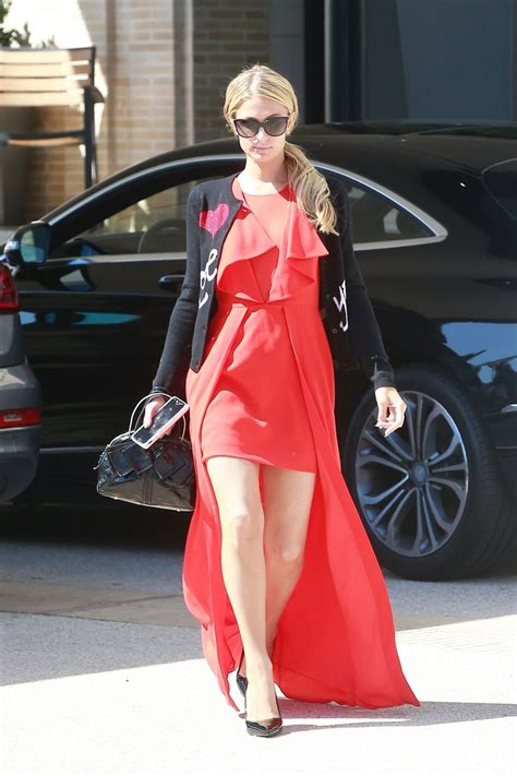 Hiltons Stand In by Stands Out In A Bright Dress As She Goes