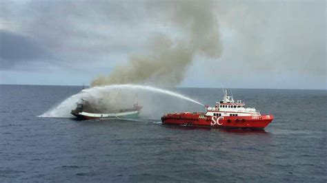 fire boat fighting fire seven rescued from fishing boat fire