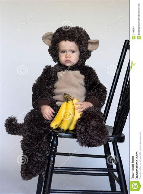 Baby Monkey Banana Suit baby in monkey costume holding banana royalty free stock photo cartoondealer 5639049