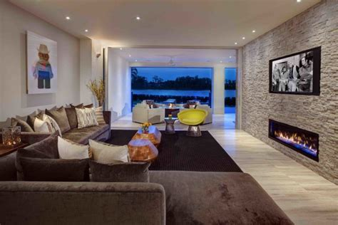 stacked stone fireplaces   warm  modern    home