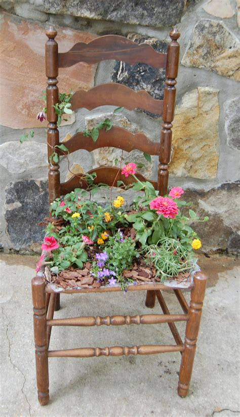 an chair takes front seat in the garden when it
