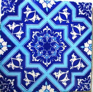 the thrifty decorator painting moroccan tiles on a kitchen shelf