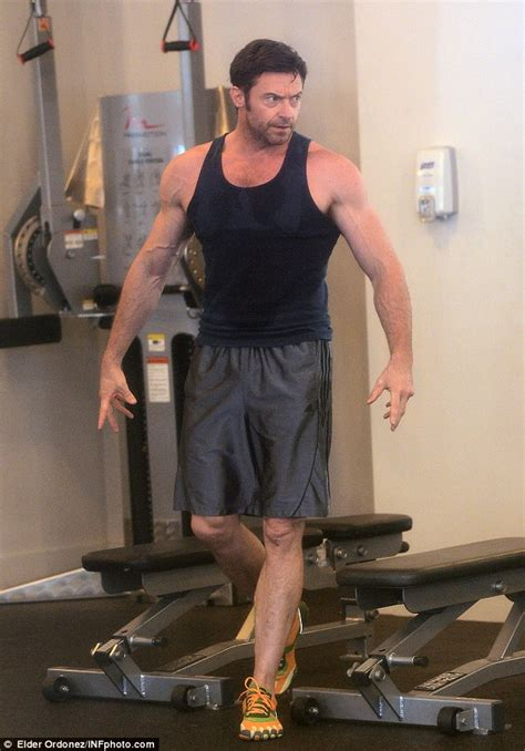 hugh jackman bench hugh jackman flexes his mean biceps and rock hard abs