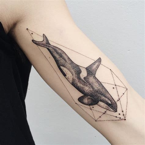 killer tattoo designs orca whale on inner bicep with prismatic power geometry