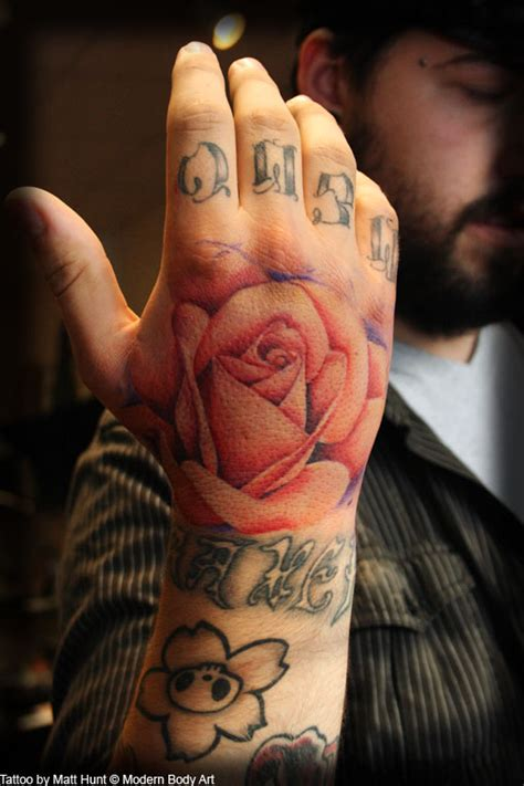 rose tattoo on hand with name 50 amazing rose hand tattoos