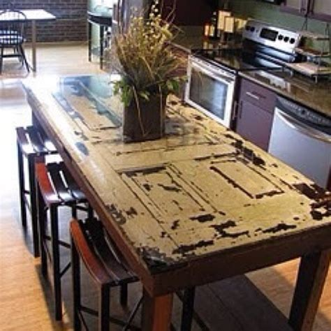 original antique door dining table house stuff pinterest door dining table antique doors an old door made into a table refinished furniture