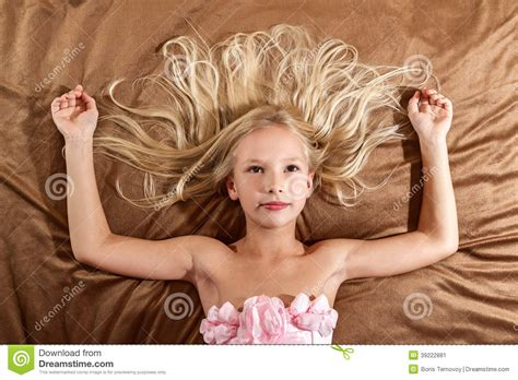 girls naked in bed beautiful little girl dreaming on bed stock photo image