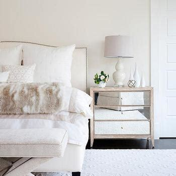 faux fur headboard white and ivory bedroom with bay window transitional