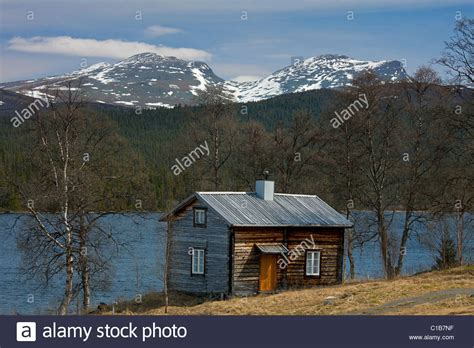 log cabin sweden log cabin along lake at fatmomakke lapland sweden stock