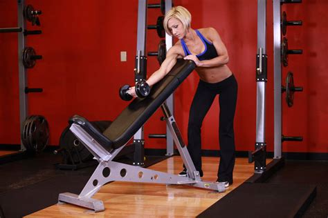 incline bench curls standing one arm dumbbell curl over incline bench exercise