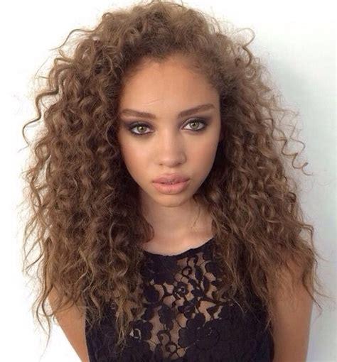 beautiful light skinn women with curly hair black dress curly hair green eyes light skin long hair