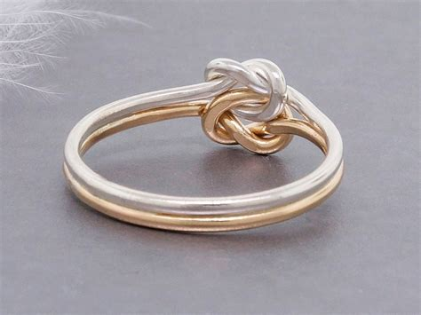 gold and silver knot engagement ring thick
