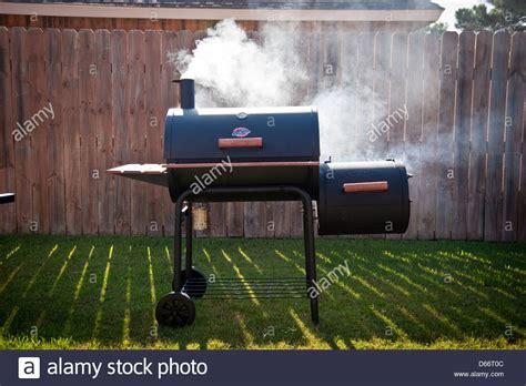 backyard bbq belton tx backyard smoker making texas barbeque with mesquite stock photo gogo papa