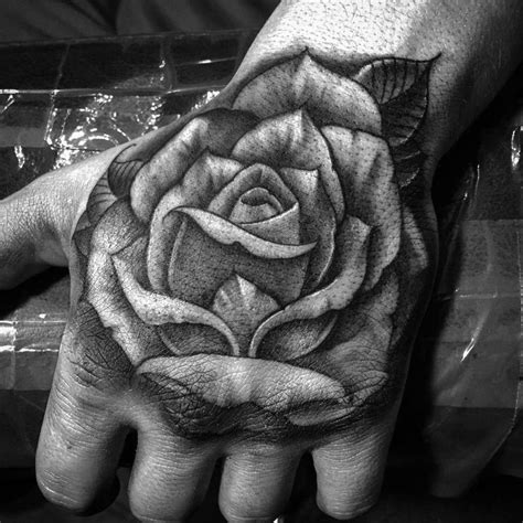 freehand rose hand tattoo by sir twice tattoos