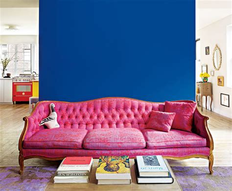 pretty pink classic sofa furniture with blue accents wall color design and stacked books at