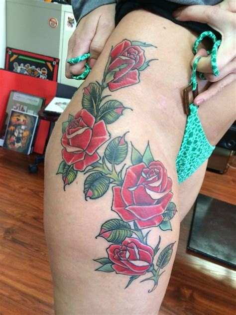traditional roses on thigh hip leg tattooed by josh