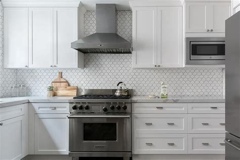 White Arabesque Tiles with Black Grout   Transitional