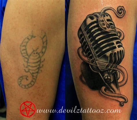 tattoo of old school microphone tattoo art work by tattoo artist cover up tattoo on a