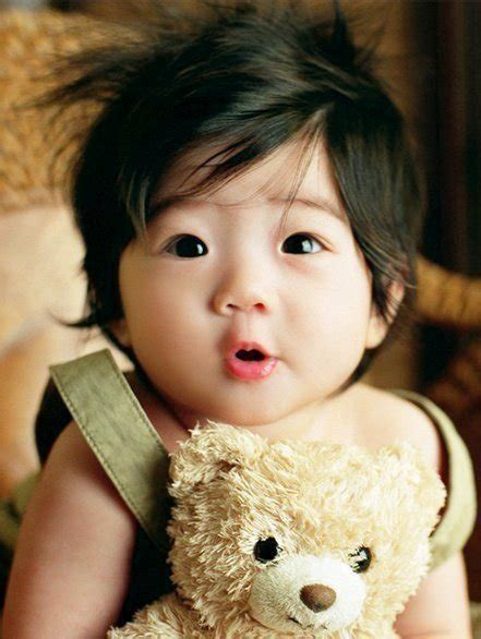 cute korean baby girl cute korean baby photo with dark hair and teddy bear