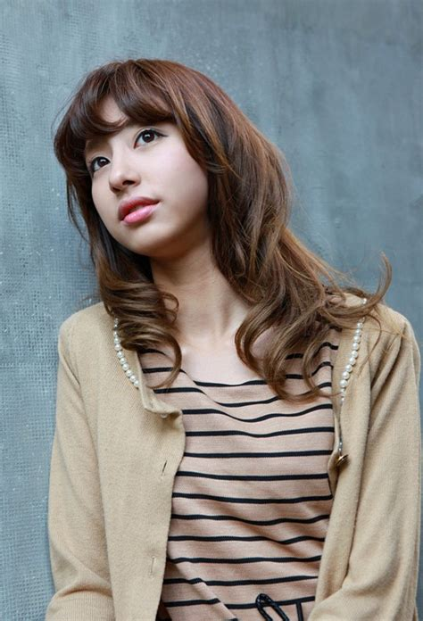 curly asian hairstyles asian girls shoulder length wavy hairstyle with full bangs
