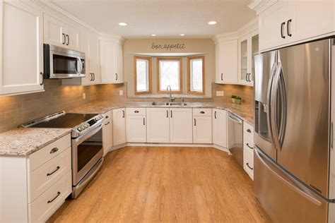 updating oak kitchen cabinets before and after updating oak cabinets doors floors trim living with