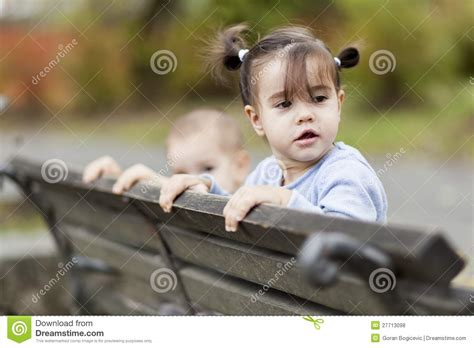 kid on bench kids on the bench royalty free stock photos image 27713098