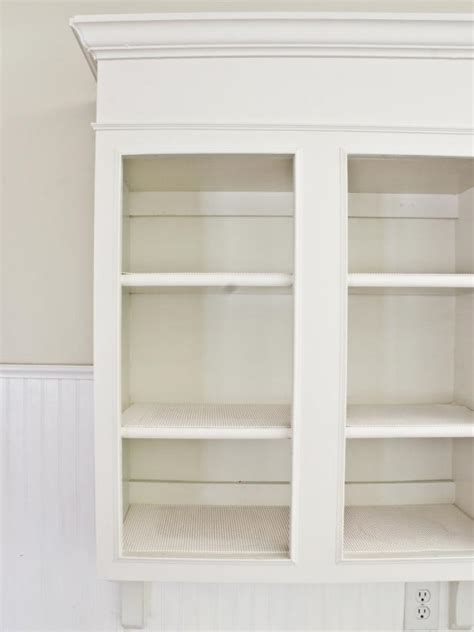 white antiqued kitchen cabinets distressed and antiqued kitchen cabinets hgtv