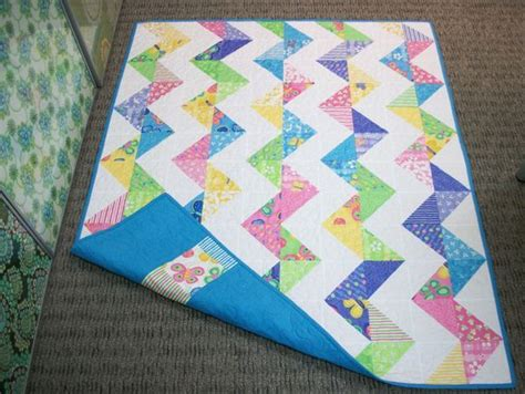 zig zag pattern called made with two charm packs of fabric called butterfly fling