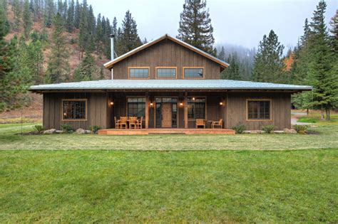 Pole barn house exterior rustic with heavy wood panels wooden garden fencing