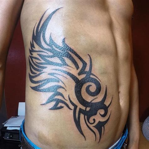 tribal rib tattoos for guys tribal wings
