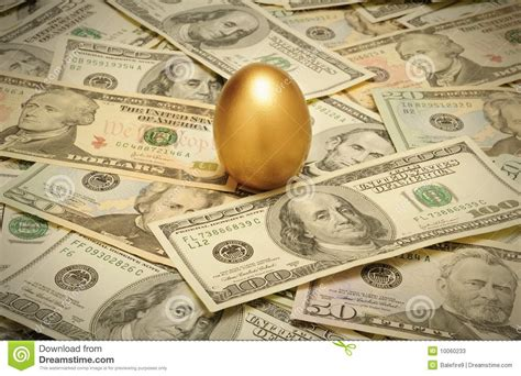 gold nest egg on a layer of stock photos image