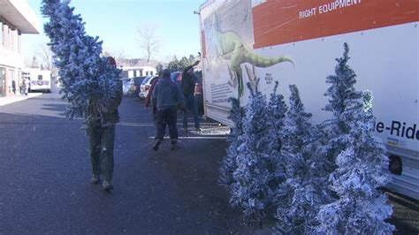 couple gives decorated christmas trees to families in need