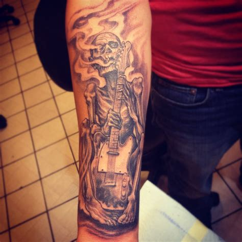 inborn tattoo with his fender guitar by jerez