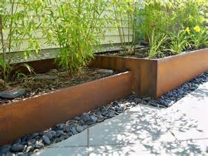 rusted steel planters and bamboo contemporary