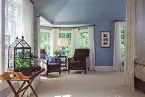 transitional master bedroom with bay window sitting area