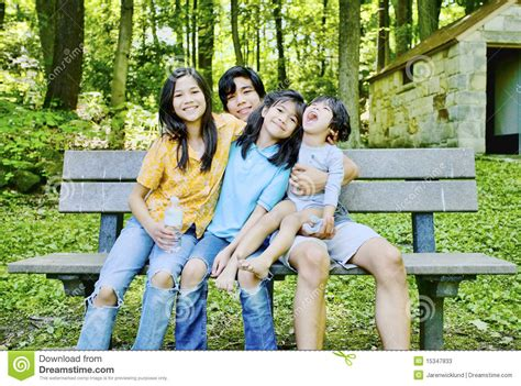 kid on bench four kids sitting on bench stock photos image 15347833