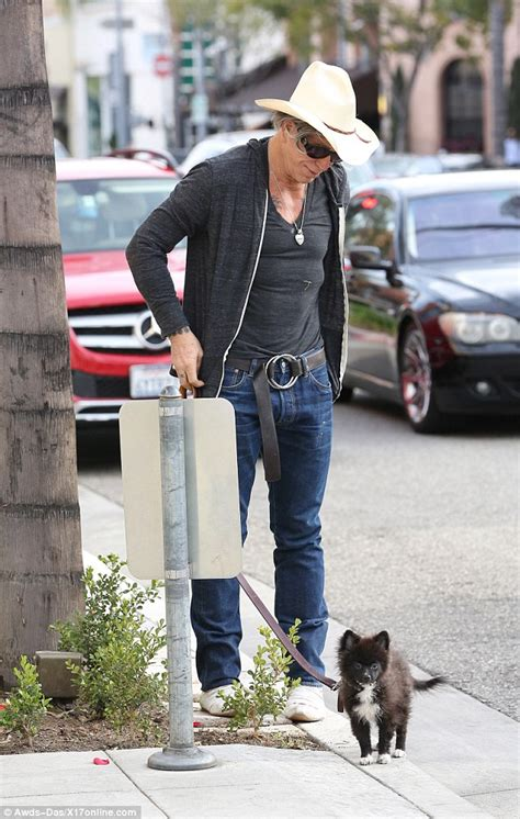 my pomeranian is limping mickey rourke steals a smoke while wearing a cowboy hat and boots daily mail