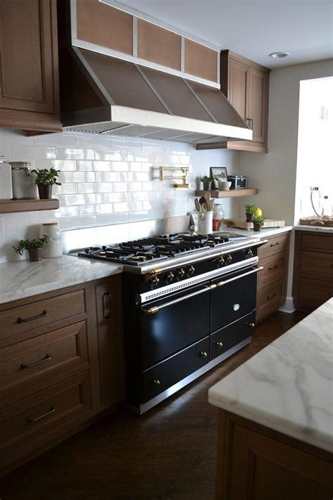 backsplash with maple cabinets gold asymmetrical kitchen with white stove