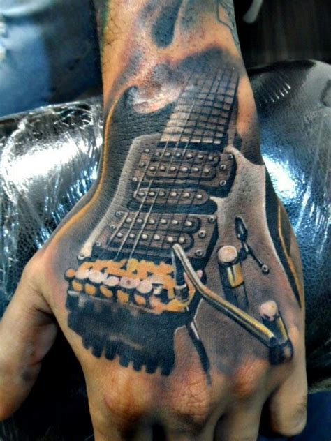 amazing guitar tattoo on hand