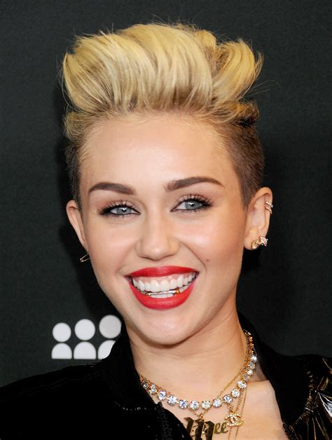what is the name of miley cryus hair cut miley cyrus saturn tattoo she s not wrong time